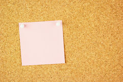 Pink clear sticker pined on the cork. Board / your text Royalty Free Stock Images
