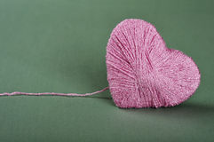 Pink clew in shape of heart Royalty Free Stock Photos