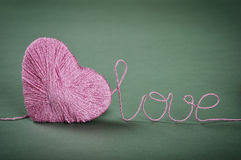 Pink clew in shape of heart Stock Photography