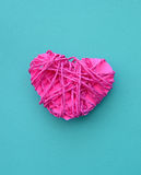 Pink clew in shape of heart (love concept). Royalty Free Stock Image