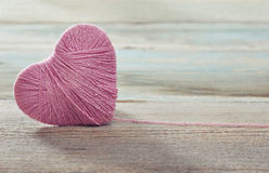 Pink clew in shape of heart Royalty Free Stock Image