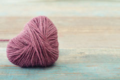 Pink clew in shape of heart Royalty Free Stock Photography