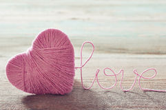 Pink clew in shape of heart Royalty Free Stock Photo