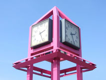 Pink clock construction. In the center of the city royalty free stock photo