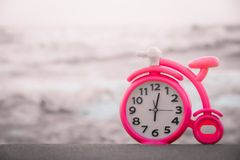 Pink clock on sand Stock Photography