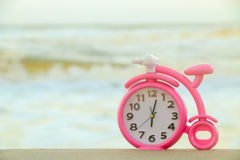 Pink clock on sand Royalty Free Stock Photography