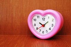 Pink clock Stock Photo