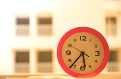 Pink clock on the table. In thailand Royalty Free Stock Photos