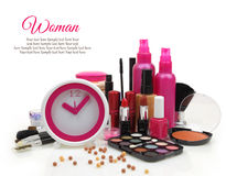 Pink clock with various cosmetics Royalty Free Stock Images