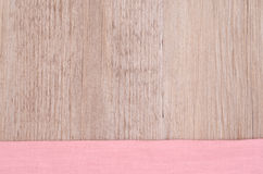 Pink cloth on a wooden background Stock Images