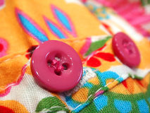 Pink Clothes Button. On Printed Fabric Stock Photography