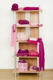Pink clothes nicely arranged on a shelf. Stock Photo