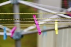 Pink clothespin on drying rack in Umea royalty free stock photo