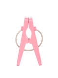 Pink clothespin isolated on white Stock Photo