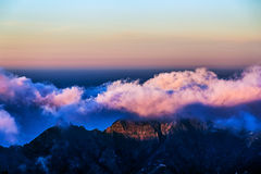 Pink clouds over mountain and sky horizon Stock Images