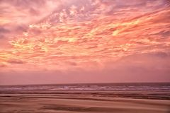 Pink clouds at sunset royalty free stock images