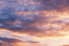 Pink clouds at sunset, evening sky, beautiful background royalty free stock image