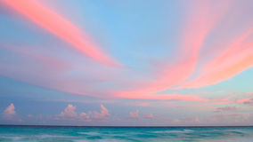 Pink Clouds at Sunset. On tropical beach Royalty Free Stock Image