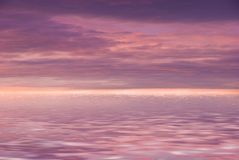 Pink cloudy sky. Pink sky reflection in a water Royalty Free Stock Photo