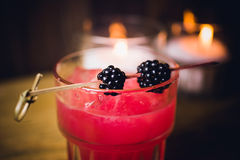 Pink cocktail with berries on top Royalty Free Stock Photos