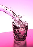 Pink cocktail drink pouring into glass Royalty Free Stock Photos