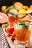 Pink cocktail with fresh grapefruit Royalty Free Stock Photos