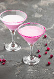 Pink cocktail, milk, with sugar on the edge of the cup. Pink milkshake in a glass for martini with sugar on the edge Stock Images