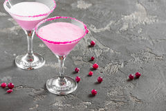 Pink cocktail, milk, and sugar in the glass. Pink milkshake in a glass for martini with sugar on the edge Royalty Free Stock Image