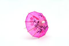 Pink cocktail umbrella, front view. A pink cocktail umbrella, front view Stock Photography