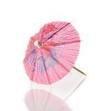 Pink cocktail umbrella isolated against white background Stock Photo