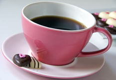 Pink coffee cup with chocolate hearts Stock Photo