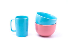 Pink coffee cup and light blue bowl and pink bowl. Isolated with white background. bowls over bowls., bowls pastel tone Royalty Free Stock Photography