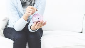 Pink coin jar for women. stock images