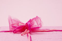 Pink color gift box with ribbon Stock Photos