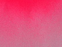 Pink color Spray Paint on white paper for background royalty free stock photography