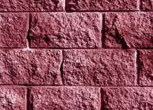 Pink color stylized brick wall pattern. Royalty Free Stock Image