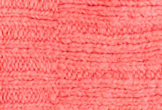 Pink color texture of knitted woolen fabric for wallpaper. Color Stock Images
