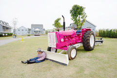 Pink color tractor in the farm Stock Photo