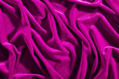 Pink color velvet textiles for background or texture, wrinkled and shadows royalty free stock photo