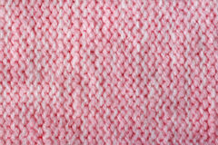 Pink color wool knitted background closeup Stock Image