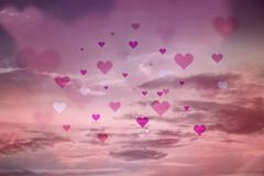 Pink colored blurry hearts on the sky royalty free stock image
