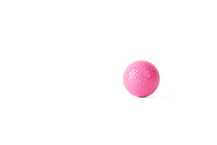 Pink colored colf ball. Isolated on white Royalty Free Stock Photo
