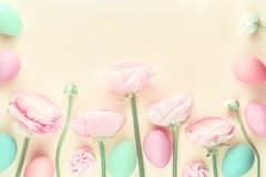 Pink pastel colored flowers and easter eggs royalty free stock image