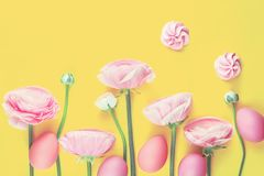 Pink colored flowers and easter eggs stock image