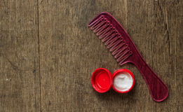 Pink comb and hair gel Stock Photography