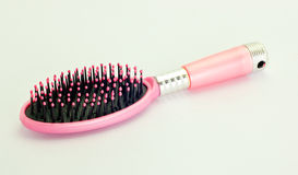 Pink comb on a white background. Stock Images