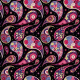 Pink commas on black background. Bright seamless paisley pattern with geometric flowers Royalty Free Stock Photo