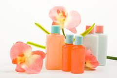 Pink Composition: Cosmetics with Flower. Perfume bottles with artificial butterfly orchid Stock Photos
