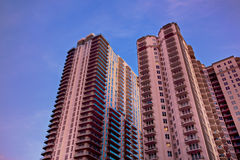 Pink condo with blue sky Stock Image