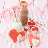 Pink cookies and milk Royalty Free Stock Images